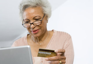 old woman holding her insurance card